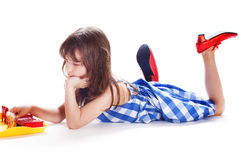 Cute little girl playing in the dollhouse Royalty Free Stock Image