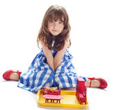 Cute little girl playing in the dollhouse Royalty Free Stock Images