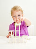 Cute little girl playing domino Stock Photo