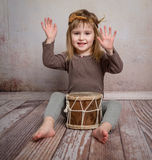 Cute little girl playing drum Stock Photography