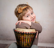Cute little girl playing drum Stock Photo