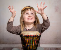 Cute little girl playing drum Stock Images