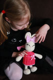 Cute little girl playing with Easter crochet bunny Stock Photography