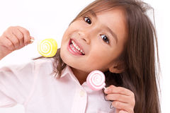 Cute little girl playing, eating sugar jelly sweet candy Royalty Free Stock Photos