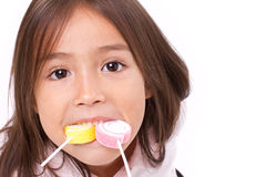 Cute little girl playing, eating sugar jelly sweet candy Stock Photo