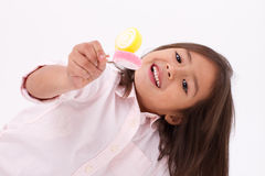 Cute little girl playing, eating sugar jelly sweet candy Royalty Free Stock Photo