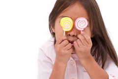 Cute little girl playing, eating sugar jelly sweet candy Stock Images