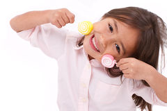 Cute little girl playing, eating sugar jelly sweet candy Royalty Free Stock Images