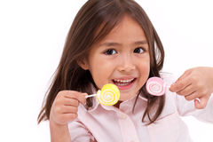 Cute little girl playing, eating sugar jelly sweet candy Stock Photography
