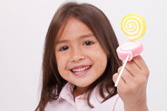 Cute little girl playing, eating sugar jelly sweet candy Royalty Free Stock Photography