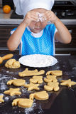 Cute little girl playing with a flour Stock Photography