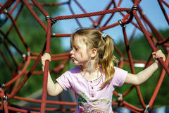 Cute little girl playing game on child playground Royalty Free Stock Photo