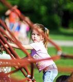 Cute little girl playing game on child playground Royalty Free Stock Photography