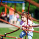 Cute little girl playing game on child playground Stock Photo