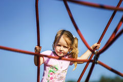 Cute little girl playing game on child playground Stock Photography