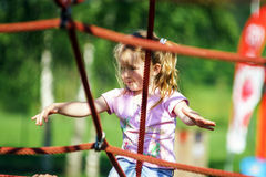 Cute little girl playing game on child playground Royalty Free Stock Images