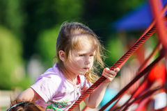 Cute little girl playing game on child playground Royalty Free Stock Image