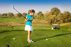Cute Little Girl Playing Golf On A Field Outdoor Royalty Free Stock Images