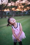 Cute little girl playing at the greensward Royalty Free Stock Photo