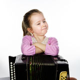 Cute little girl playing harmonica, music education concept Royalty Free Stock Photo
