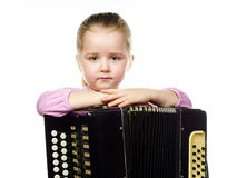 Cute little girl playing harmonica, music education concept Royalty Free Stock Image