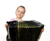 Cute little girl playing harmonica, music education concept Royalty Free Stock Photos