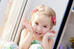 Cute little girl playing Royalty Free Stock Image