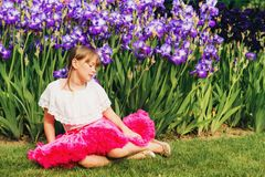 Pretty little girl playing in a beautiful garden Stock Photo