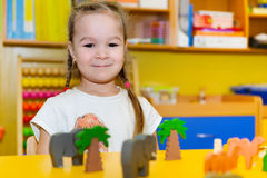 Cute little girl playing in kindergarten Stock Photo