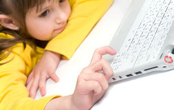 Cute little girl playing on laptop Stock Photo