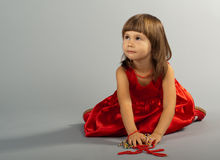 Cute little girl playing with necklaces Royalty Free Stock Photography
