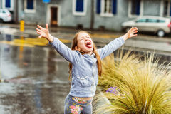 Free Cute Little Girl Playing Outdoors Stock Photo - 80426700