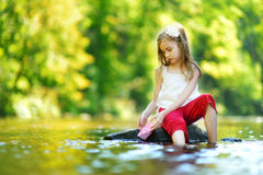 Cute little girl playing with paper boat Stock Photography