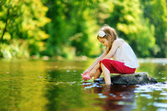 Cute little girl playing with paper boat Royalty Free Stock Photography