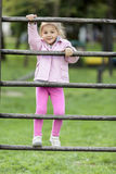 Cute little girl playing in park Stock Photos