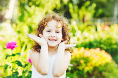 Cute little girl playing peekaboo. Instagram filter. Stock Image