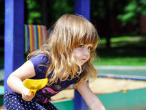 Cute little girl playing on playground Royalty Free Stock Photography