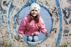 Cute little girl playing on playground Stock Image
