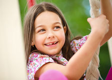 Cute little girl is playing in playground Stock Photo