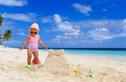 Cute little girl playing with sand on the beach Stock Photography