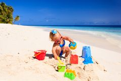 Cute little girl playing with sand on beach Royalty Free Stock Photos
