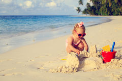 Cute little girl playing with sand on beach Royalty Free Stock Photography