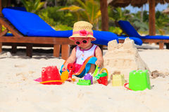 Cute little girl playing with sand on beach Stock Photography