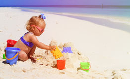 Cute little girl playing with sand on beach Royalty Free Stock Image