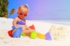 Cute little girl playing with sand on beach Royalty Free Stock Photo