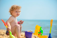 Cute little girl playing with sand Royalty Free Stock Image