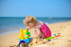 Cute little girl playing with sand Stock Photography