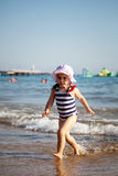 Cute little girl playing on sea beach Royalty Free Stock Photography