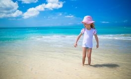 Cute little girl playing in shallow water at Royalty Free Stock Image