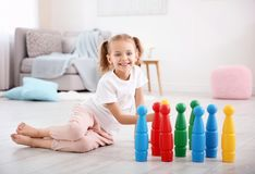 Cute little girl playing with skittles. At home Royalty Free Stock Photo